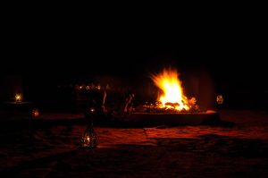 Campfire under the stars in the Sahara Desert near Erg Chigago, Morocco