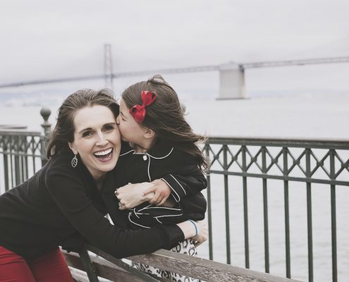 Wanderglow - beauty meets wanderlust. Camden and Nicole in San Francisco by Bay Bridge. cute kiss.