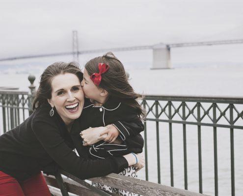Wanderglow - beauty meets wanderlust. Camden and Nicole in San Francisco by Bay Bridge. cute kiss.