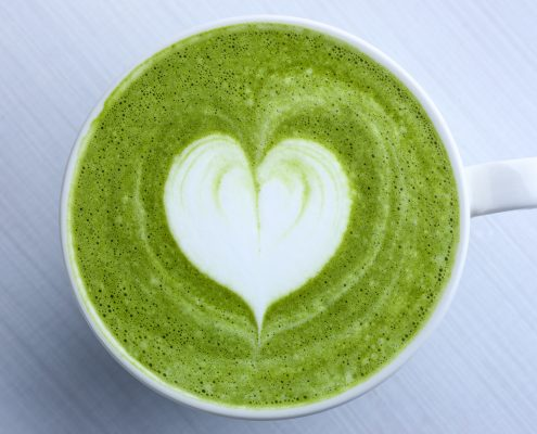 matcha latte with collagen and superfood in heart shape